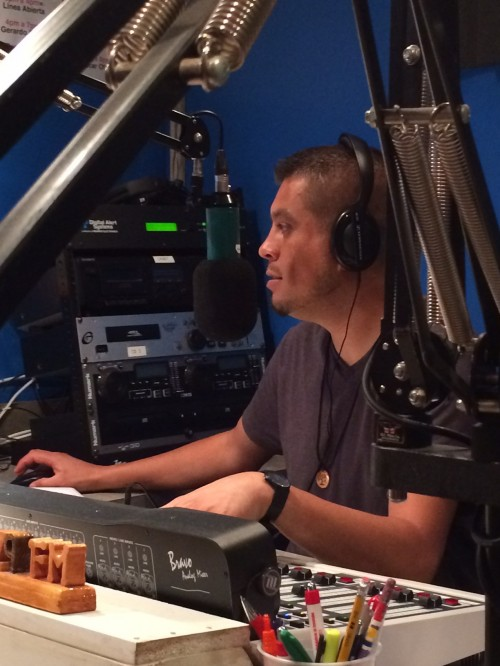 Gerardo speaks to farmworkers on his daily radio show on Radio Tuyo.
