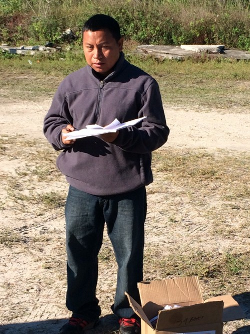 Oscar prepares to facilitate an education session for farmworkers in the tomato fields near Immokalee.