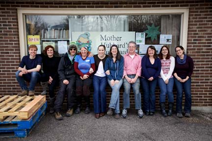 MHC staff in front of the organization's food pantry. Photo by Josh Franer.