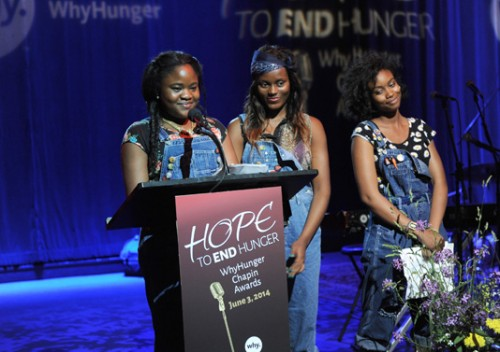 "Youth from WhyHunger partners EcoStation:NY in Brooklyn give a special keynote address at the 2014 WhyHunger Chapin Awards, ""Hope to End Hunger,"" at Hard Rock Cafe New York in Times Square. A farm constructed by EcoStation:NY was a feature at the event. From left to right: Iyeshima Harris, Benia Darius, Kristina Erksine"