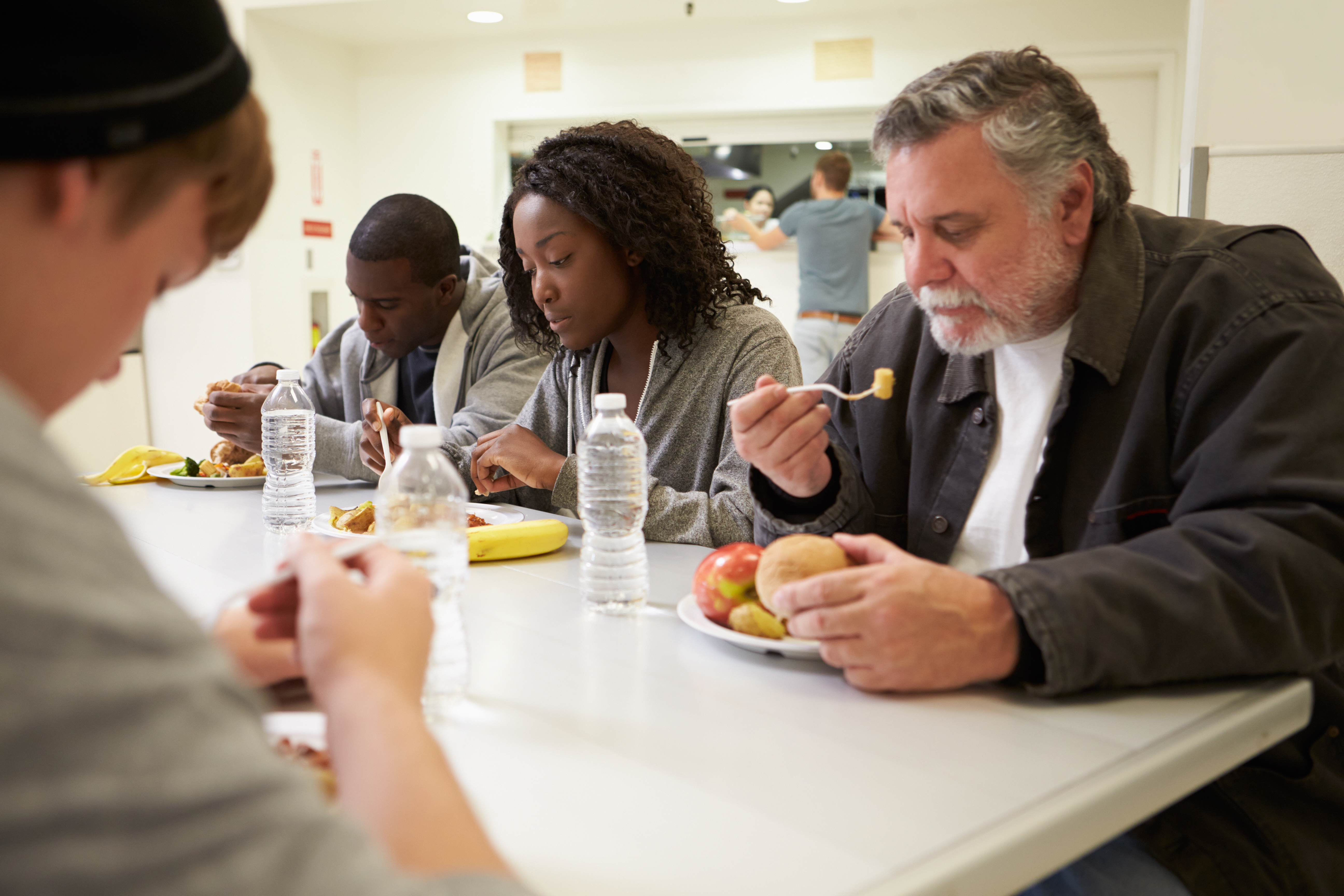 Amazing People Sitting At Table Eating Food In Homeless Shelter Download Free Architecture Designs Embacsunscenecom
